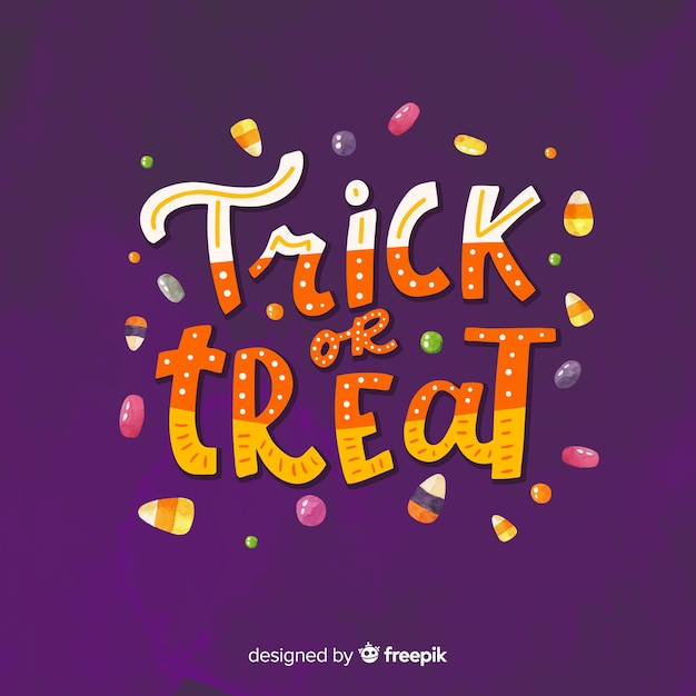 Colorful trick or treat lettering Free Vector