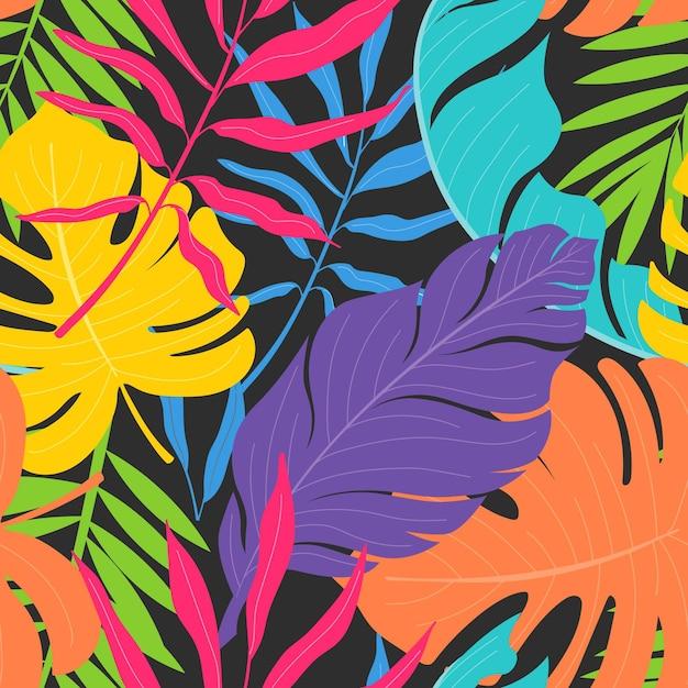 Modello di foglie e fiori esotici colorati Vettore gratuito