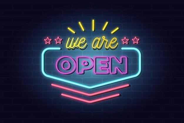 カラフルなネオン「私たちは開いています」サイン Premiumベクター