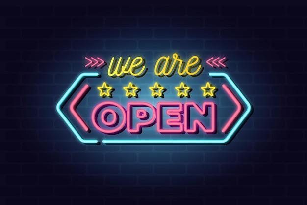 カラフルなネオン「私たちは開いています」サイン 無料ベクター