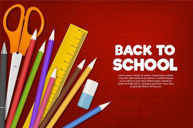 Articoli di cancelleria colorati di nuovo a sfondo scuola Vettore gratuito
