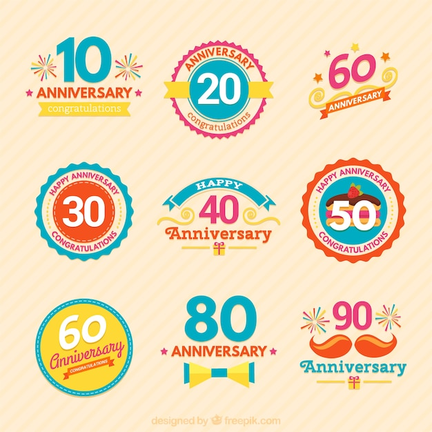 Colourful variety of anniversary badges Free Vector