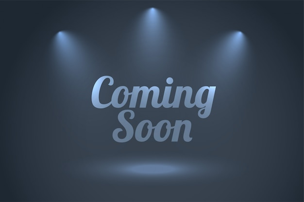 Coming soon background with focus spot lights Free Vector