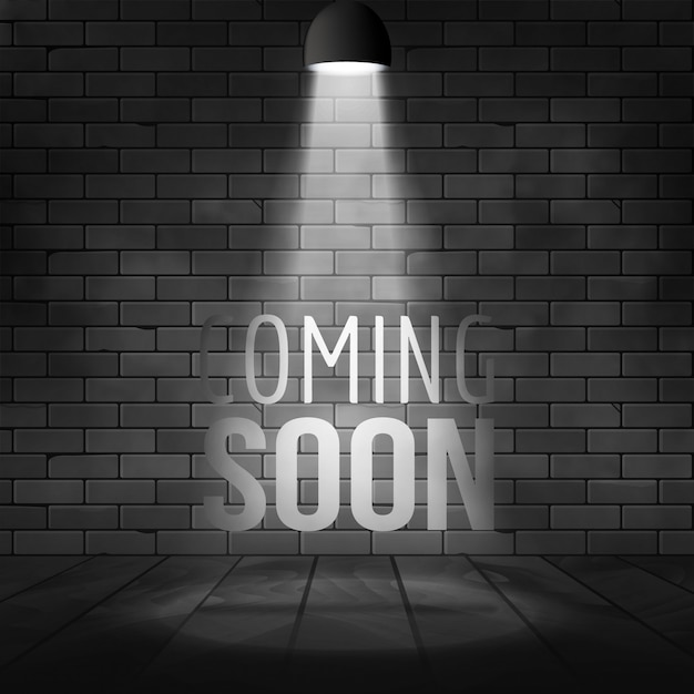 Coming soon message illuminated with light spotlight projector. brick wall and stage realistic Premium Vector