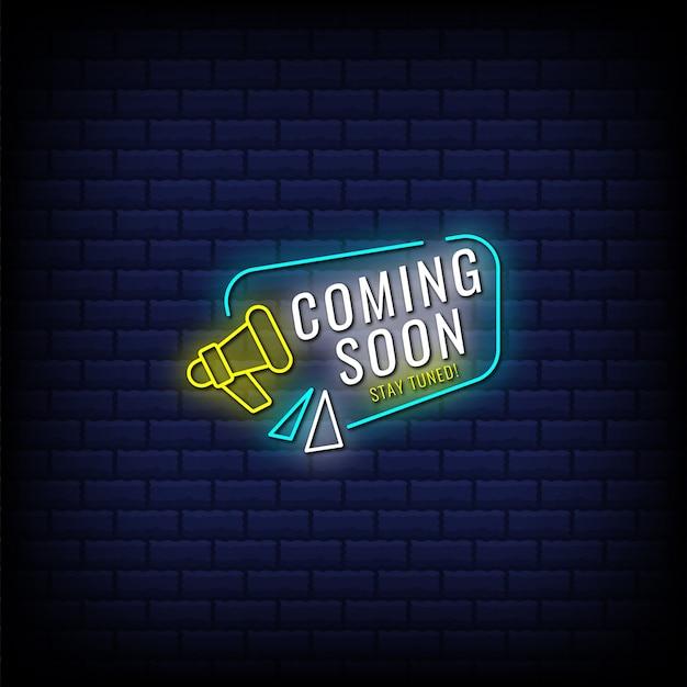 近日公開、メガホンでネオンサインスタイルのテキストをお楽しみに Premiumベクター