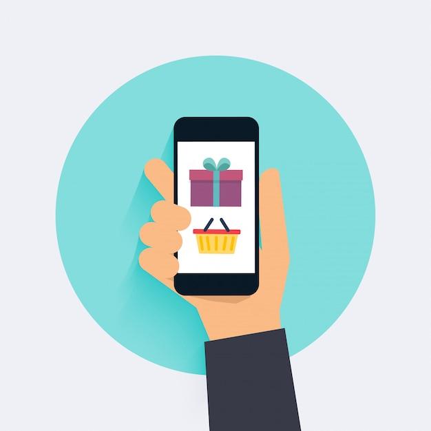 コンセプトオンラインショッピングとeコマース。モバイルマーケティングのアイコン。スマートフォンを持っている手。 Premiumベクター