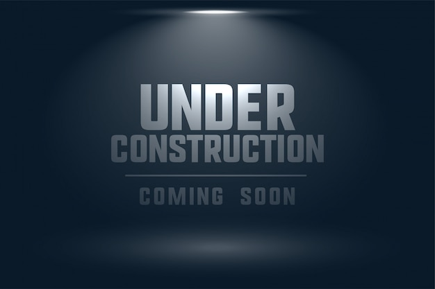 Under construction coming soon spot light background Free Vector