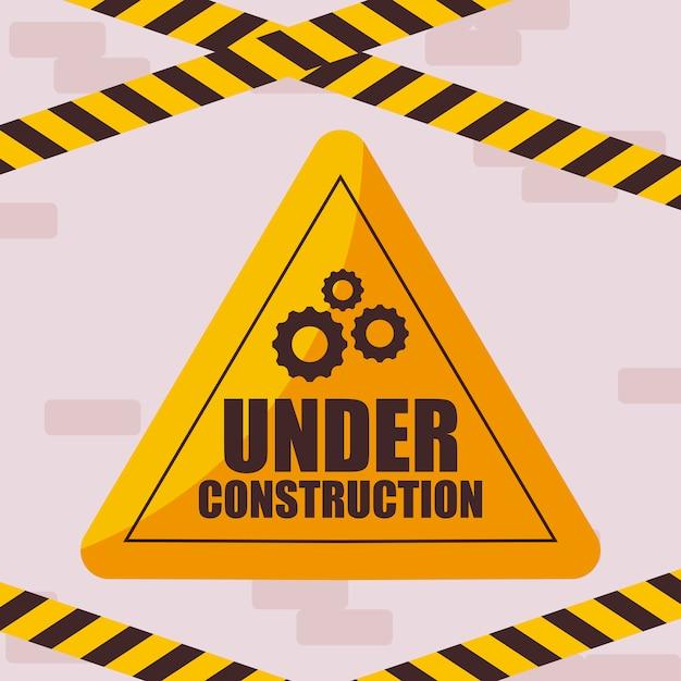 Under construction label with caution tape Premium Vector