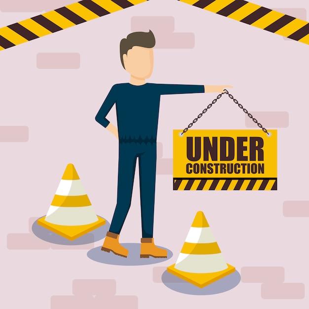 Under construction label with cones Premium Vector