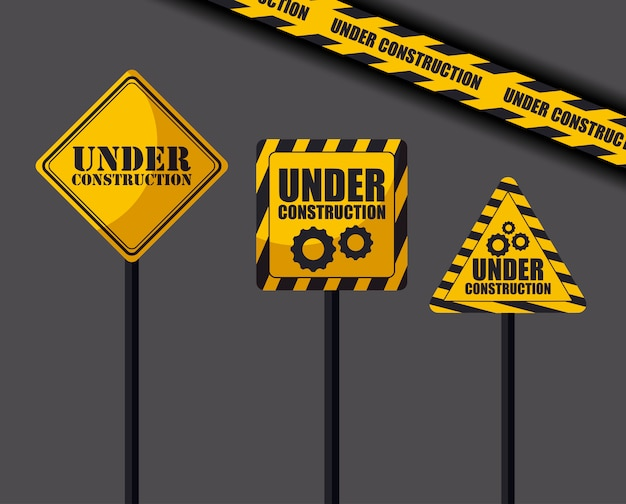 Under construction signs and caution tape Premium Vector