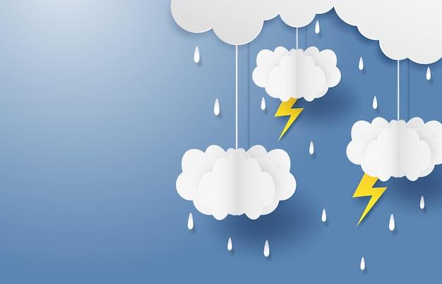 雨季のモンスーン。雲の雨と雷が青い空にぶら下がっています。 copyspaceと紙アートスタイル Premiumベクター