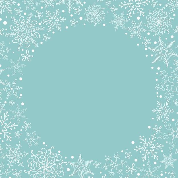 Copyspaceとクリスマス雪の花輪。グリーティングカード Premiumベクター