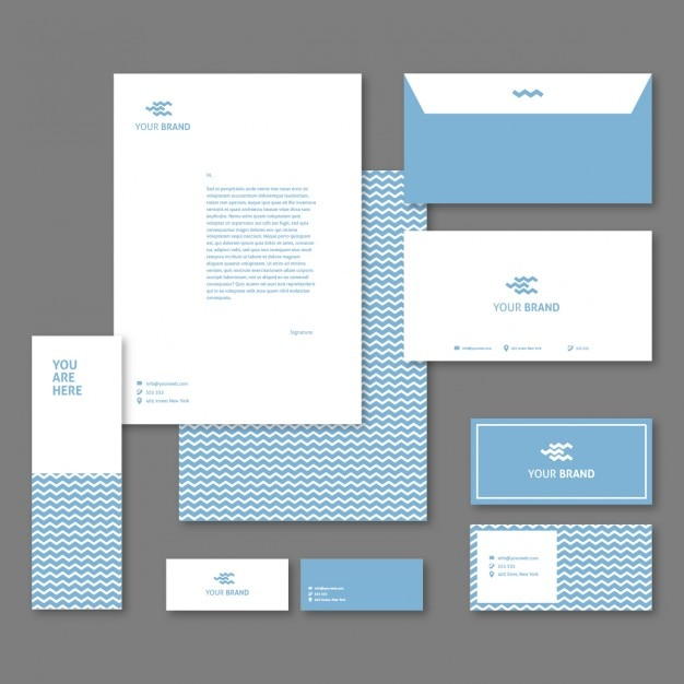 Corporative stationery with blue waves Free Vector