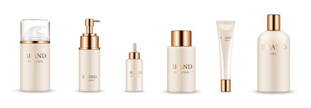 化粧品ボトル。美容液、クリーム、シャンプー、バームのリアルなゴールデンパッケージ。白い背景で隔離のベクトル化粧品のモックアップ。金色の帽子のイラスト化粧品 Premiumベクター