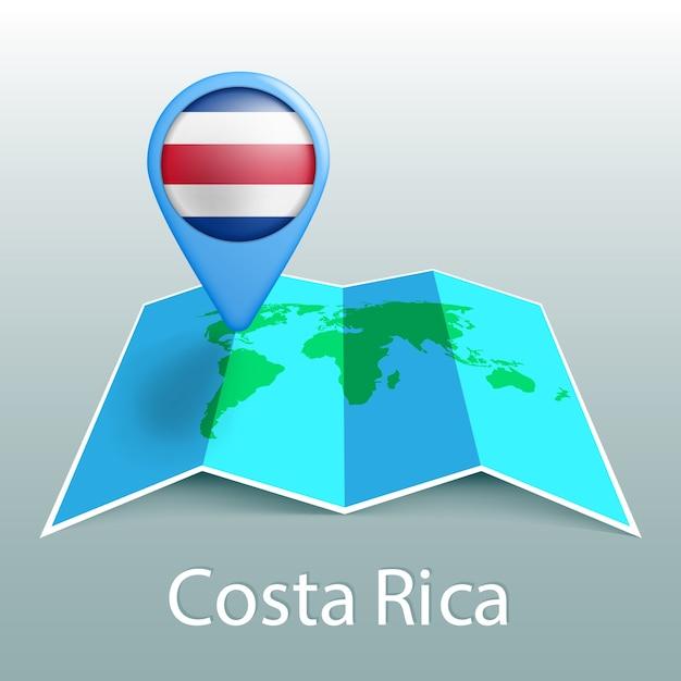 灰色の背景に国の名前とピンでコスタリカの旗の世界地図 Premiumベクター