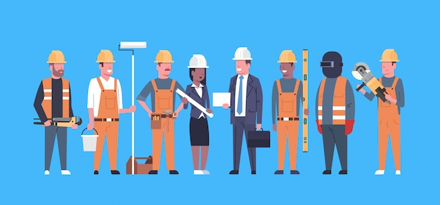 Costruction workers team industrial technicians mix race man and woman builders group Premium Vector