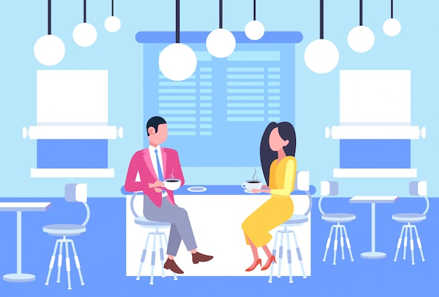 Couple man woman coworkers sitting at cafe table business people having informal meeting in coffee shop discussing relationship concept full length horizontal Premium Vector