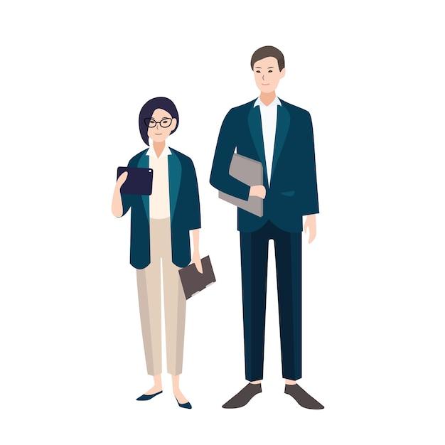 ビジネス服やスマートスーツに身を包んだ人々のカップル。男性と女性の店員または分離されたオフィスワーカーのペア。フラットカラフルな漫画のキャラクター。ベクトルイラスト。 Premiumベクター