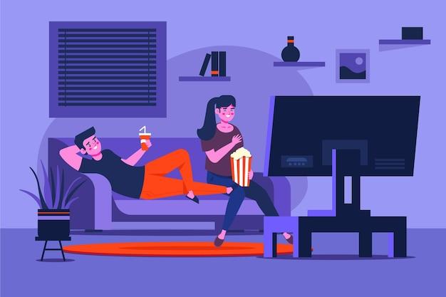 映画を見ているソファの上のカップルします。 Premiumベクター