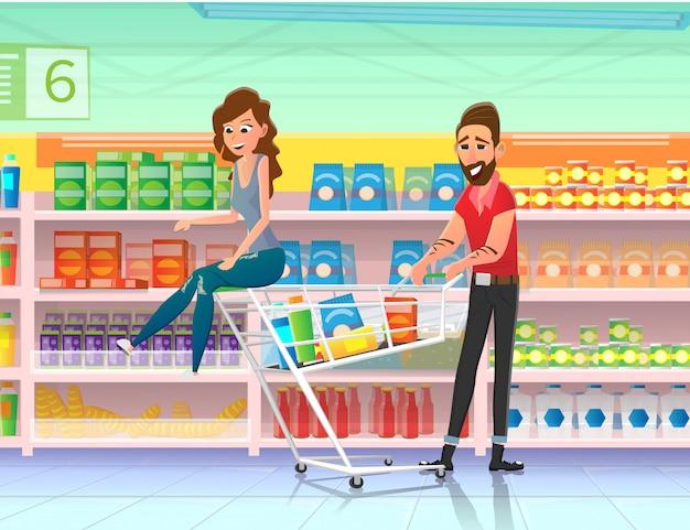 Couple riding shopping cart in supermarket flat. Premium Vector