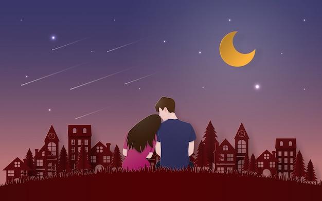 Couple sitting on grass floor looking meteor Premium Vector