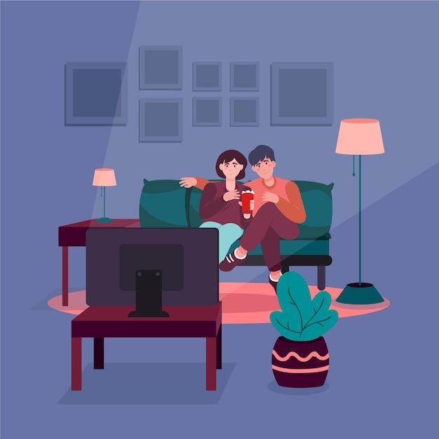 Coppia guardando un film insieme a casa Vettore gratuito