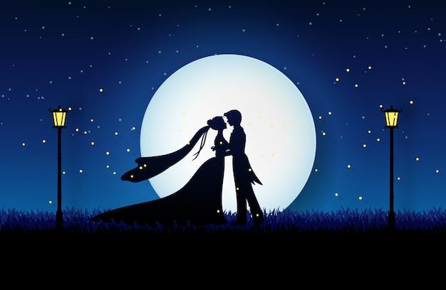 Couple in wedding dress hugging on the meadow garden Premium Vector