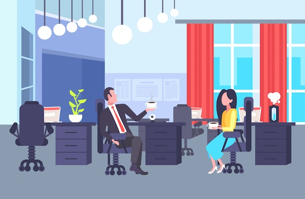 Coworkers couple sitting at workplace colleagues discussing together during coffee break man woman business people talking office co-working center interior horizontal full length Premium Vector