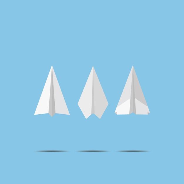 Самолеты белой бумаги летая на стену голубого неба. craft дизайн в стиле оригами, просто векторная графика Premium векторы