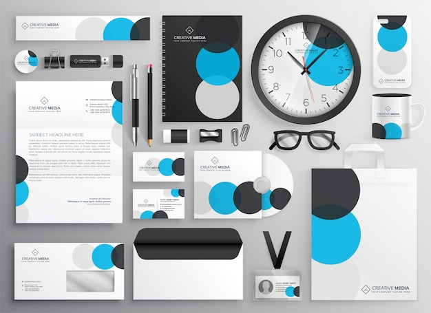Creative circle stationery set for business branding Free Vector