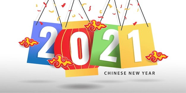 Concetto creativo del capodanno cinese 2021 su carta colorata appesa. Vettore gratuito