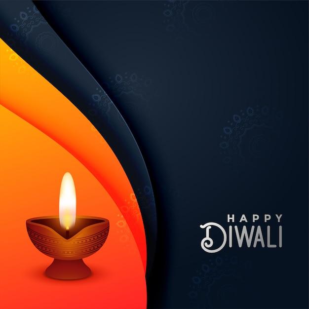 Creative diwali diya in orange and black colors Free Vector