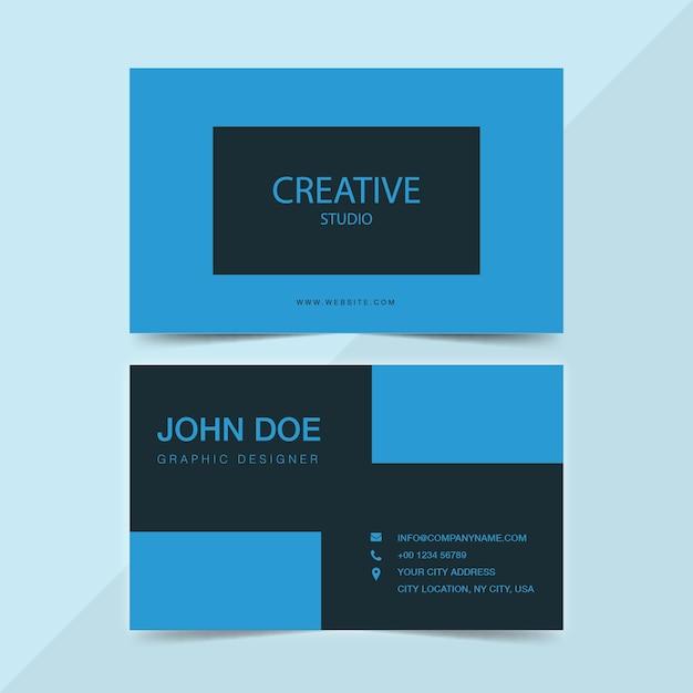 Creative studio business card in blue Premium Vector