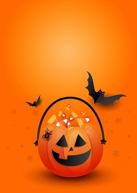 コピースペースとオレンジ色の背景に怖い黒いコウモリとクリエイティブな垂直ハロウィーンキャンディパンプキンバッグ。 Premiumベクター