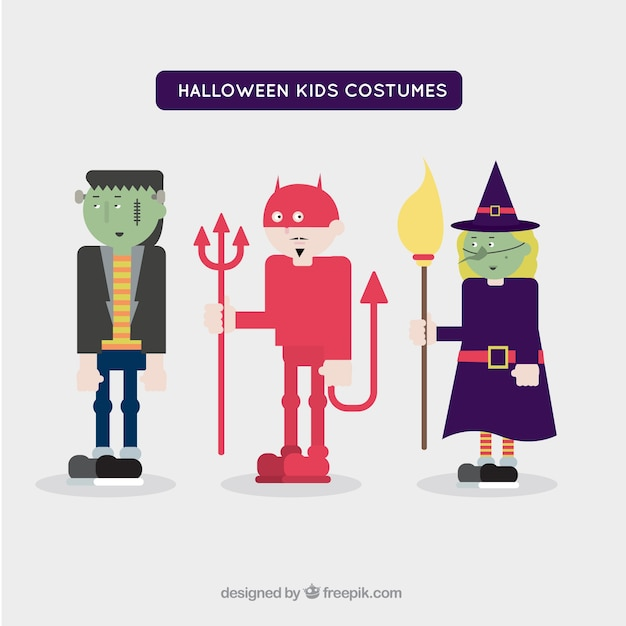 Creepy children wearing halloween\ costumes