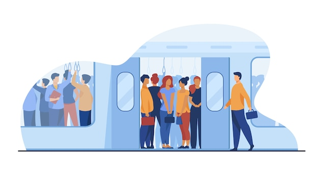 Crowd of commuters traveling by subway train Free Vector
