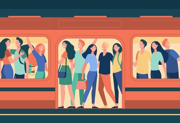 地下鉄で旅行する幸せな人々の群衆。駅で混雑した地下鉄の車に立っている乗客。人口過剰、ラッシュアワー、公共交通機関、通勤者の漫画イラスト 無料ベクター