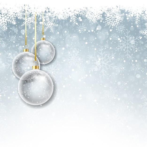 Хрустальные шары на фоне снега Бесплатные векторы