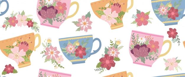 花と葉が白いシームレスパターンに分離された美しい茶cup。 Premiumベクター