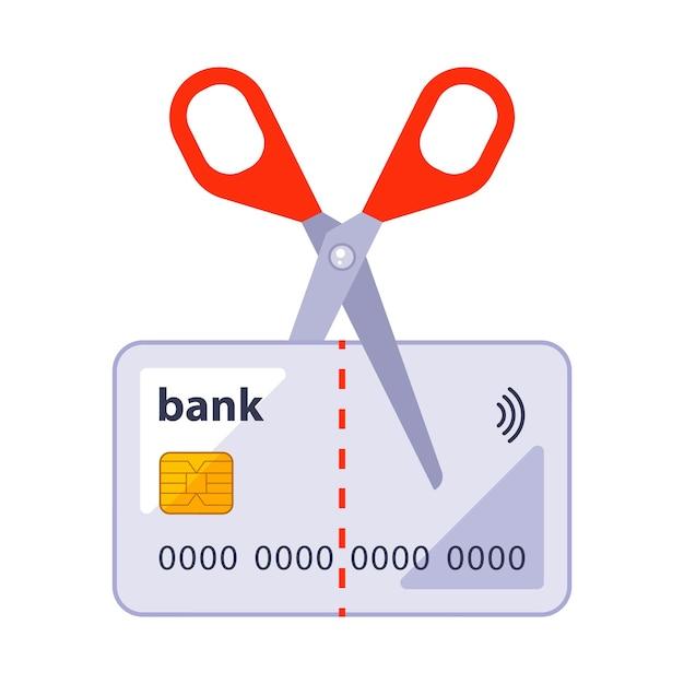 白い背景で隔離はさみのイラストで古い銀行カードをカットします。 Premiumベクター