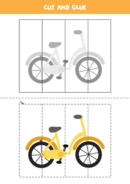만화 자전거로 아이들을위한 게임을 자르고 붙입니다. 미취학 아동을위한 절단 연습. 프리미엄 벡터