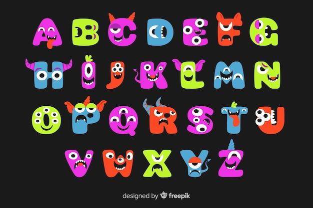 Cute animated halloween monster alphabet on black background Free Vector