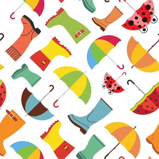 ゴム長靴と傘でかわいい秋のパターン。秋のシーズンのシームレスな背景 Premiumベクター