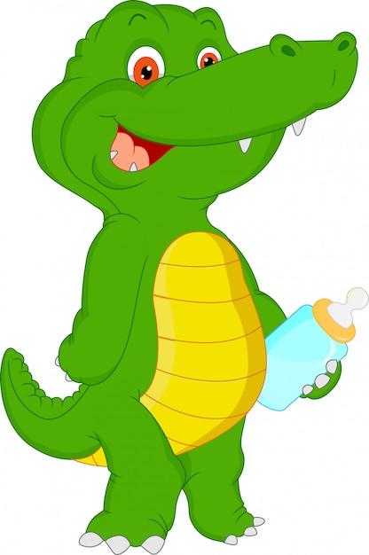 Cute baby crocodile cartoon Premium Vector
