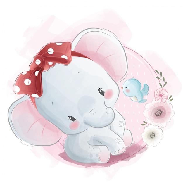 Cute baby elephant wearing read headband Premium Vector