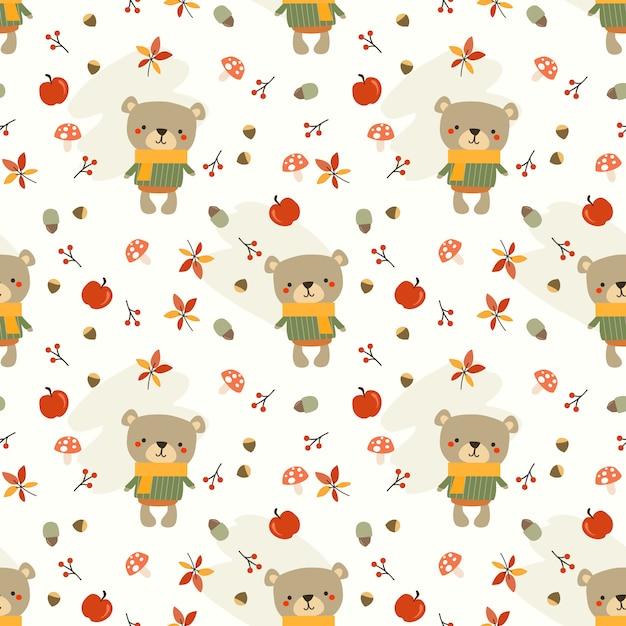 かわいいクマと秋の葉のシームレスなパターン。 Premiumベクター