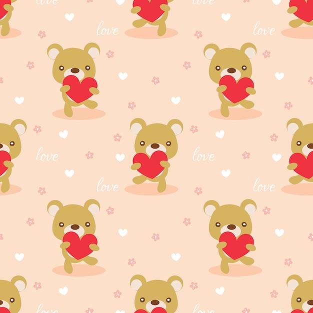 Cute bear hold a heart seamless pattern. Premium Vector