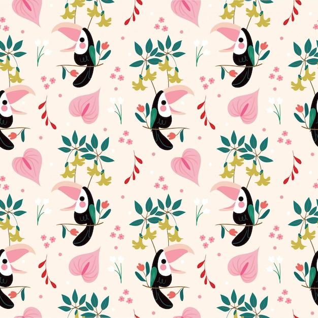 かわいい鳥とさまざまなアマゾンの花のシームレスパターン Premiumベクター