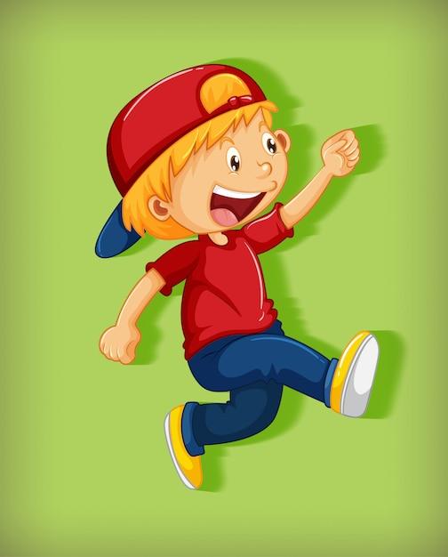 緑の背景に分離された歩行位置の漫画のキャラクターの首を絞めと赤い帽子をかぶっているかわいい男の子 無料ベクター