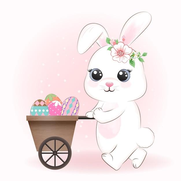 カートの中のかわいいウサギとイースターエッグ Premiumベクター